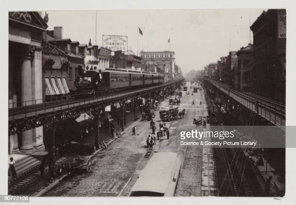 A snapshot photograph of the elevated railway in the Bowery New York taken by an unknown photographer in 1900 The elevated railway was built in the...