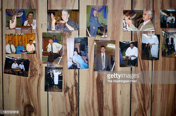 Snapshots of previous services decorate the walls of the Church of the Lord Jesus a Pentecostal 'Signs Following' church on Sept 2 in Jolo West Va...