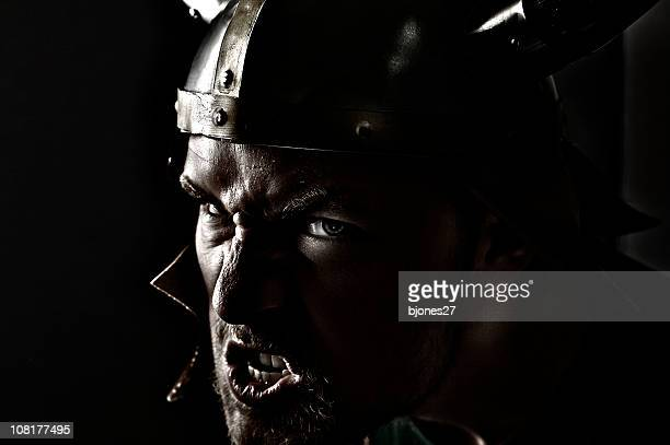 Snarling Man Wearing Viking Hat, Low Key