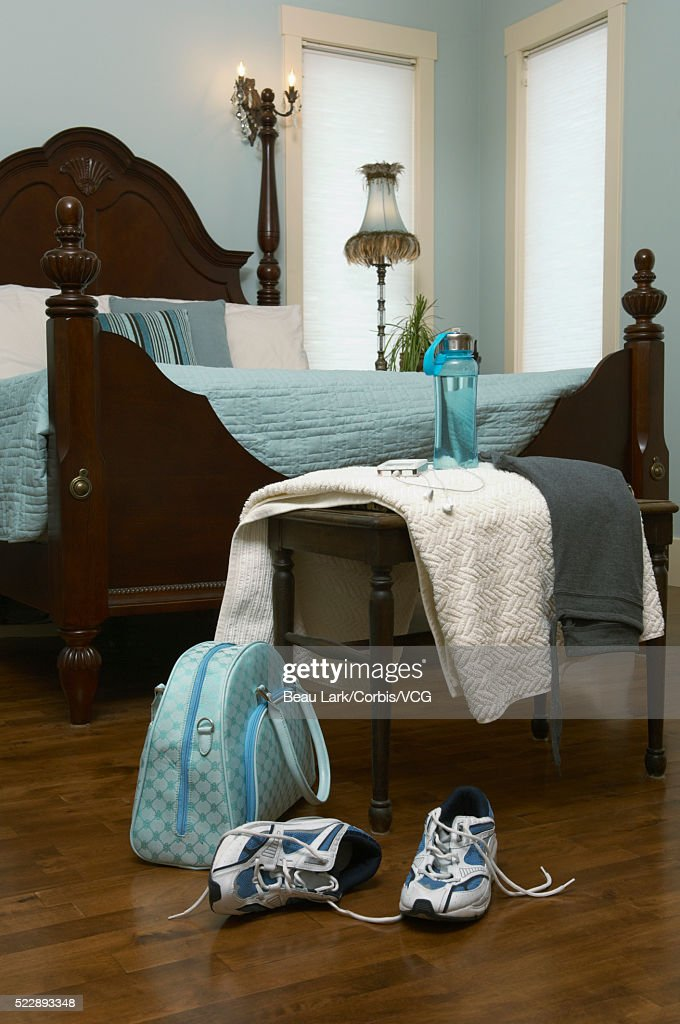 Sneakers And Gym Bag In Bedroom Stock Photo | Getty Images