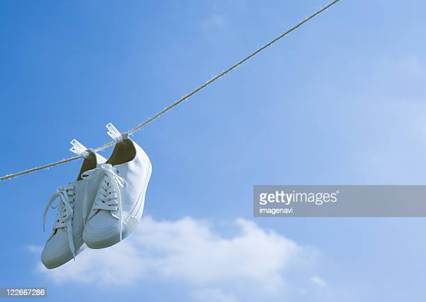 Sneakers hanging on rope