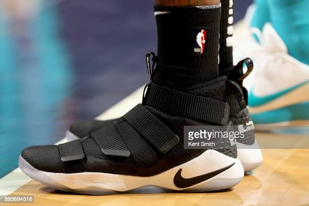 Sneakers of James Johnson of the Miami Heat during the game against the Charlotte Hornets on December 15 2017 at Spectrum Center in Charlotte North...