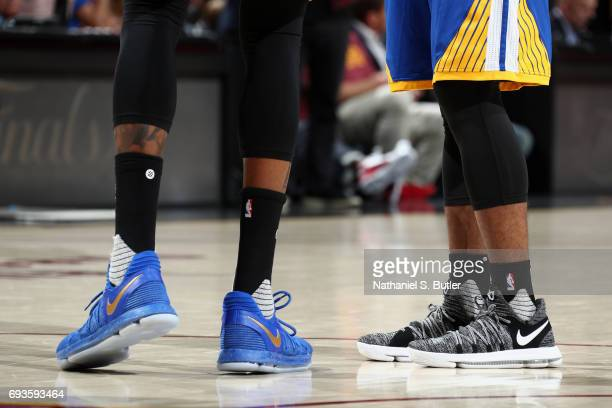 Sneakers of Kevin Durant and Ian Clark of the Golden State Warriors during the game against the Cleveland Cavaliers in Game Three of the 2017 NBA...