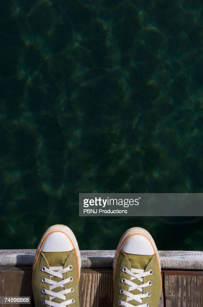 Sneakers on dock over water