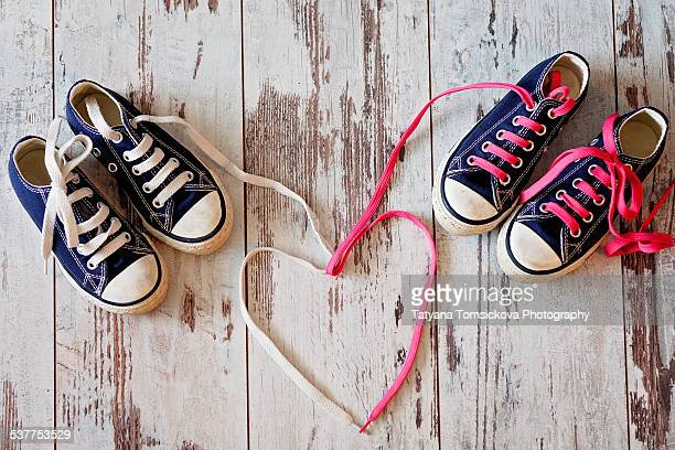 Sneakers shoelaces make the shape of heart