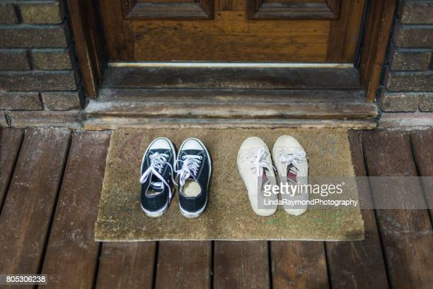 sneakers shoes on a porch - linda wilton stock pictures, royalty-free photos & images