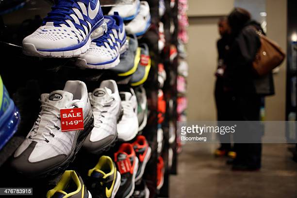 Sneakers sit on display at a Foot Locker Inc store inside the South Park Mall in Strongsville Ohio US on Tuesday March 4 2014 Foot Locker Inc is...