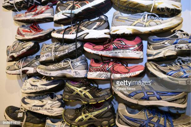 Sneakers which had been left at the scene of the 2013 Boston Marathon bombings are stacked on the wall as an art exhibition at a museum in suburban...