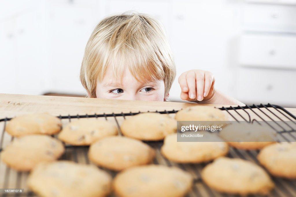 Sneaking Cookies : Stock Photo