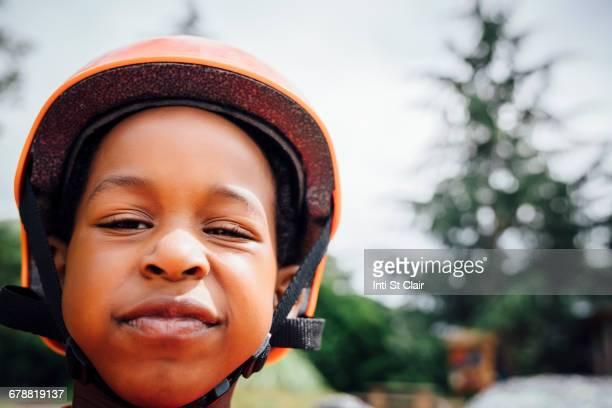 sneering black boy wearing helmet - sneering stock pictures, royalty-free photos & images