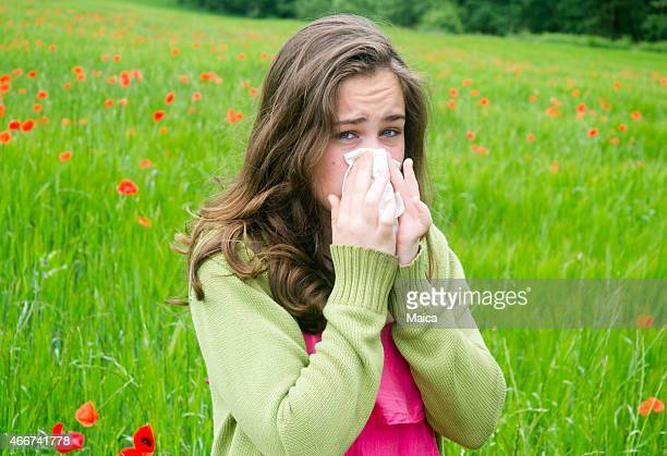 Sneezing, girl with hay fever