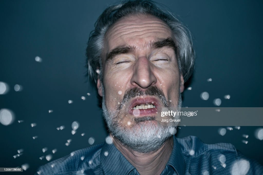 Sneezing man : Stock Photo