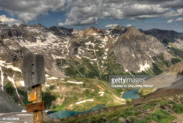 sneffels wilderness sign and blue lakes in mountains - san juan mountains stock photos and pictures
