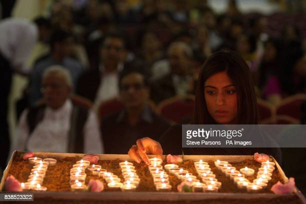Sneha Hindocha first cousin to Anni Dewani lights a candle in her memory at the Shree Kadwa Patidar Samaj in Harrow to mark her murder one year ago...
