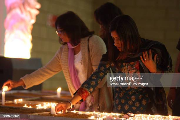 Sneha Hindocha who is first cousin to Anni Dewani lights a candle in her memory at the Shree Kadwa Patidar Samaj in Harrow to mark her murder one...