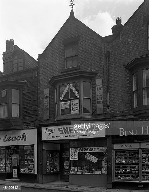 Snelsons electrical shop Mexborough South Yorkshire 1963 TVs are available to rent for 8 shillings and 3 pence per week for a 19 inch set A window...