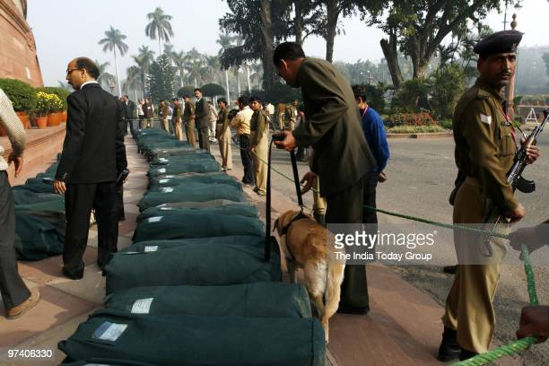 Sniffer dog checks budget papers at Parliament before Budget presentation on February 26 2010 in New Delhi
