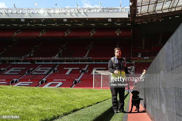 A sniffer dog patrols pitchside as the match is abandoned with fans evacuated from the ground prior to the Barclays Premier League match between...