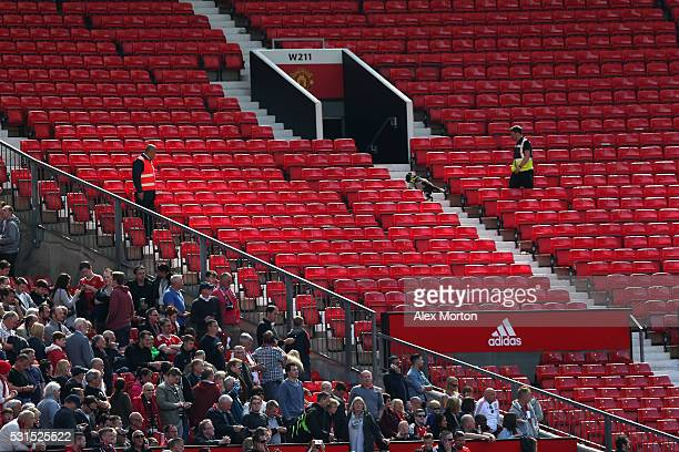 A sniffer dog patrols the stands after fans were evacuated from the ground prior to the Barclays Premier League match between Manchester United and...