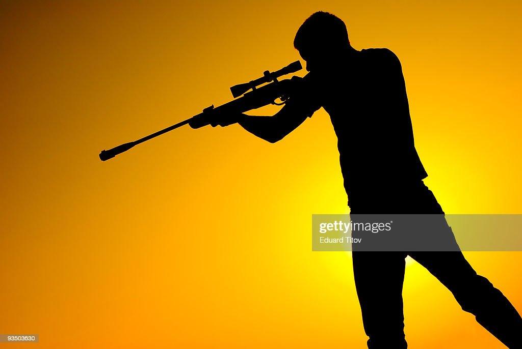 Sniper for sunset : Stock Photo