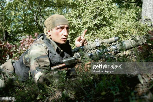 A sniper from A company 113th battalion provides cover fire for the four man unit on September 19 east of Tamaracheni South Ossetia Georgia The...