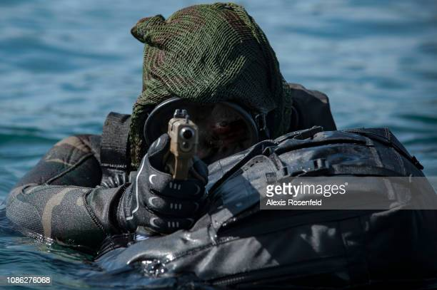 A sniper from Commando Hubert is getting out of the water during a training mission at the school of the most prestigious French Commando on April 01...