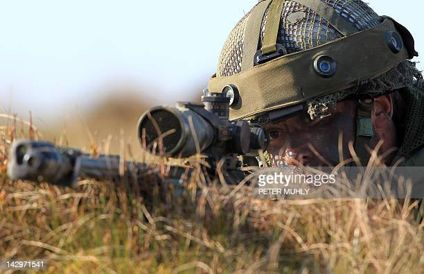 A sniper from the British 3rd Parachute Brigade looks though his scope during the 16 Air Assault Brigade Exercise Joint Warrior at West Freugh...