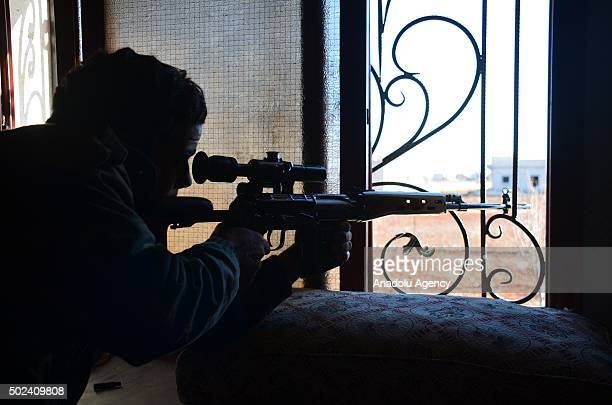 Sniper from the Syrian opposition fighters attacks DAESH militants at Kafr town in Aleppo Syria on December 24 2015