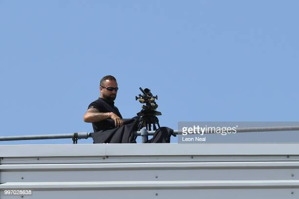 A sniper gets a riffle out on the roof on the roof of the Harrods Aviation hanger a few minutes prior to US President Donald Trump and First Lady...