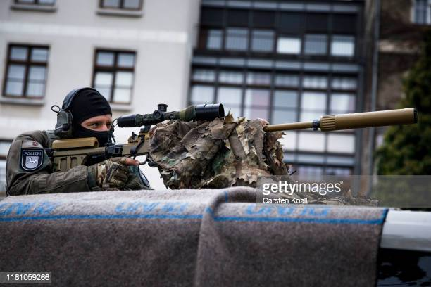 Sniper observe the area during the official ceremonies to celebrate the 30th anniversary of the fall of the Berlin Wall on November 9, 2019 in...