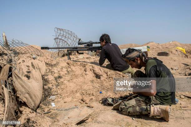 A sniper of the Hashd AlShaabi during an offensive to drive out Islamic State militants on September 24 2017 in Hawija Iraq The Hashd AlShaabi...