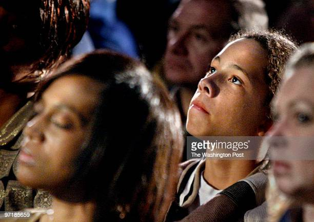 Sniper shooting victim Iran Brown looks up in contemplation during the vigil for the sniper victims and families In foreground at left is Denise...