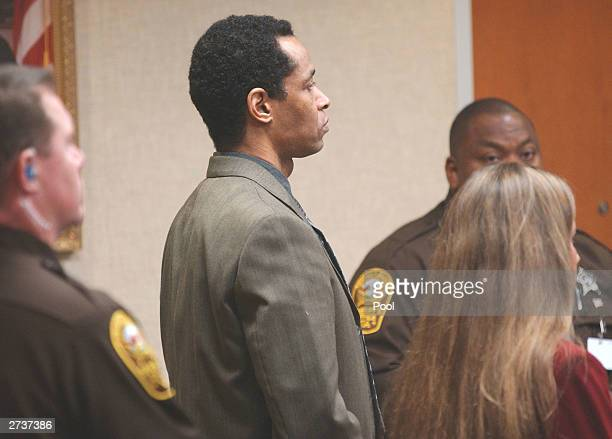 Sniper suspect John Allen Muhammad 42yearsold stands as a verdict of guilty on all four counts is read in courtroom 10 at the Virginia Beach Circuit...