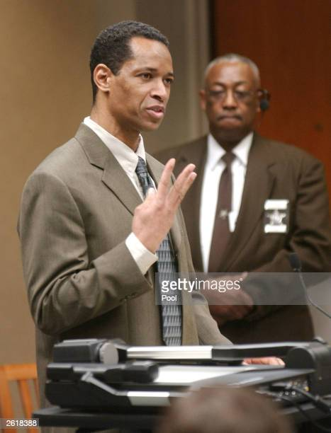 Sniper suspect John Allen Muhammad address the jury as he delivers his opening argument as Prince William County bailiff Jack Fullmore watches during...