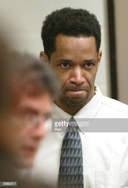 Sniper suspect John Allen Muhammad is escorted into courtroom 10 at the Virginia Beach Circuit Court October 14, 2003 in Virginia Beach, Virginia....