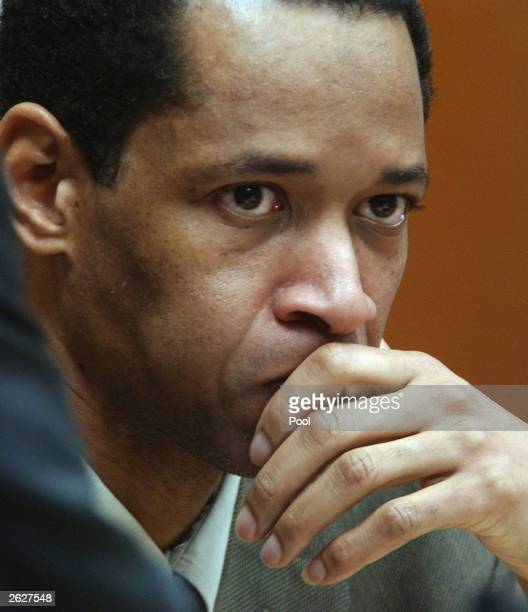Sniper suspect John Allen Muhammad listens during his murder trial in courtroom 10 at the Virginia Beach Circuit Court October 22, 2003 in Virginia...