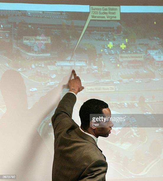 Sniper suspect John Allen Muhammad points to an area on an aerial view of the shooting scene of Dean Meyers during his trial in courtroom 10 at the...