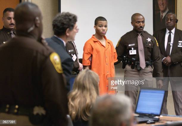 Sniper suspect Lee Boyd Malvo is escorted by deputies as he is brought into court to be identified by a witness during the murder trial in courtroom...