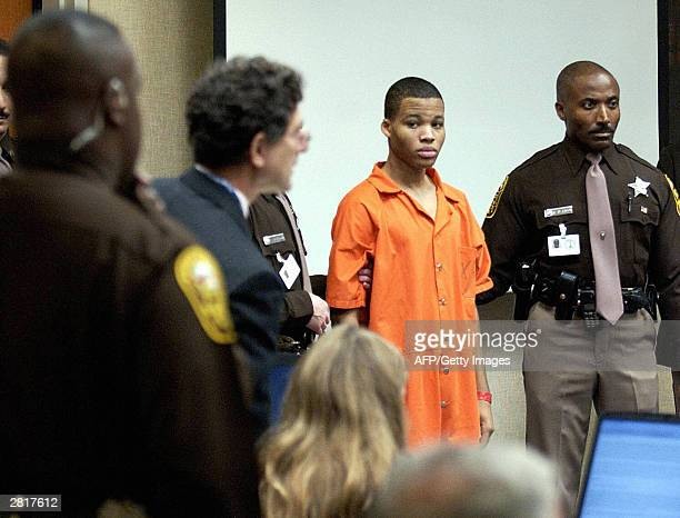 Sniper suspect Lee Boyd Malvo is escorted by deputies as he is brought into court to be identified by a witness during the murder trial for sniper...