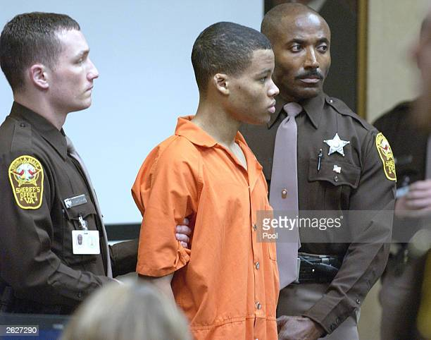 Sniper suspect Lee Boyd Malvo is surrounded by deputies as he is brought into court to be identified by a witness during the trial of sniper suspect...