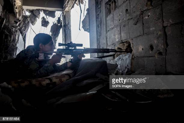 YPJ sniper takes high position in a 5 storey building overlooking ISIS position She says that ISIS uses civilians as human shields to cross open...