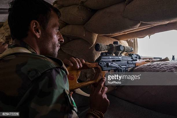 Sniper watching for ISIS movement in the villages on the roots of Bashiqa mountain on October 25 2016 The Kurdish forces of Peshmerga have surrounded...