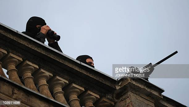 Snipers are seen on the roof of the Orangerie near Sanssouci Palace in Potsdam eastern Germany before the awarding ceremony of the M100 media prize...