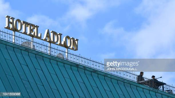 Snipers of the police are seen on September 27 2018 on the roof of the Adlon Hotel close to the Brandenburg Gate in Berlin where security measures...