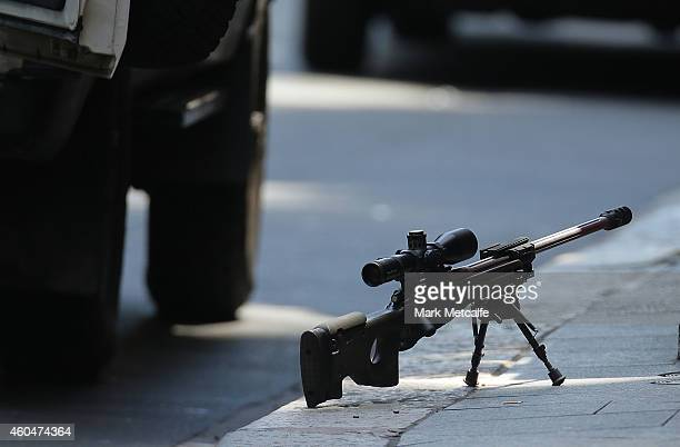 A snipers rifle is seen on the ground in Phillip St on December 15 2014 in Sydney Australia Police attend a hostage situation at Lindt Cafe in Martin...