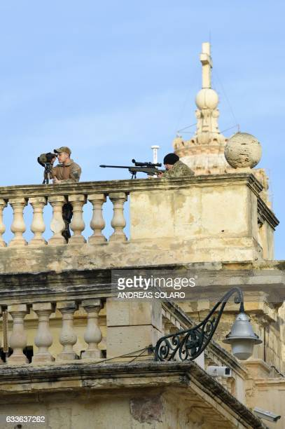 Snipers stand on a terrace to secure the area during an Informal meeting of EU heads of state or government on February 3 2017 in Valletta Malta...