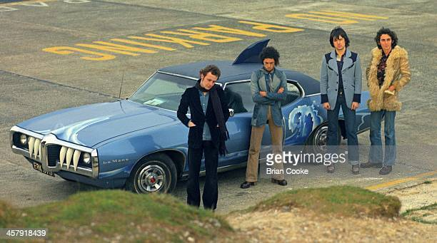 Snips , Andy Fraser, Chris Spedding and Marty Simon of Sharks photographed with The Shark Car at Beachy Head on February 7th 1973 for their album...