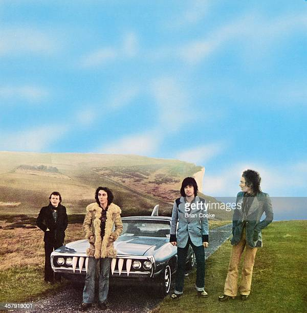 Snips , Marty Simon, Chris Spedding and Andy Fraser of Sharks photographed with The Shark Car at Beachy Head on February 7th 1973 for their album...