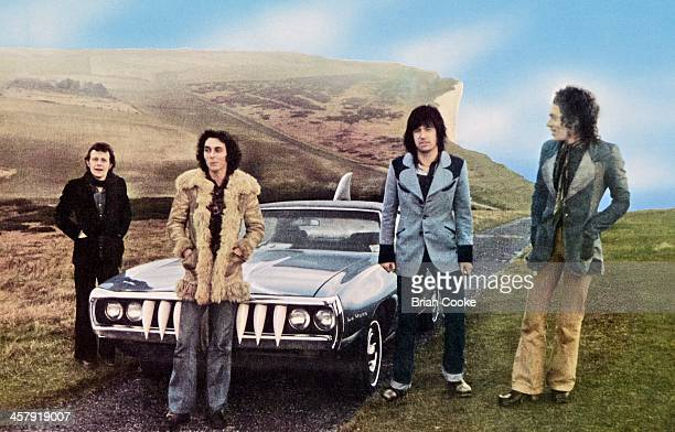 Snips Marty Simon Chris Spedding and Andy Fraser of Sharks photographed with The Shark Car at Beachy Head on February 7th 1973 for their album First...