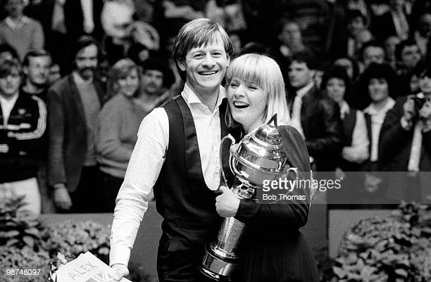 Snooker champion Alex Higgins celebrates with his wife Lynn after winning the Coral UK snooker Final at the Guildhall in Preston, 4th December 1983....